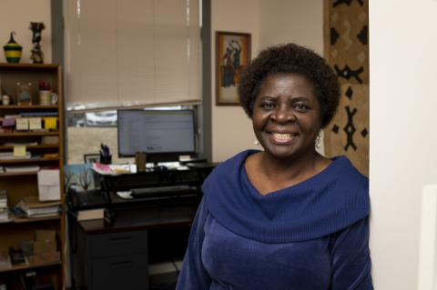 Janetrix Hellen Amuguni in her office in February. Tufts researchers are studying how sex and gender affect individuals' risk of worse outcomes from COVID-19.